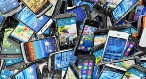 pile of used smartphones
