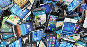 pile of used smartphones